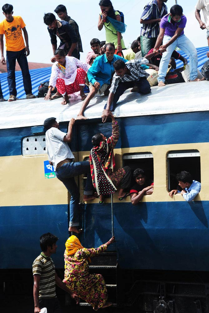 Bangladeshis cram onto a train as they rush home to be with their families in remote villages ahead of the Muslim festival of Eid al-Fitr. - Photo by AFP
