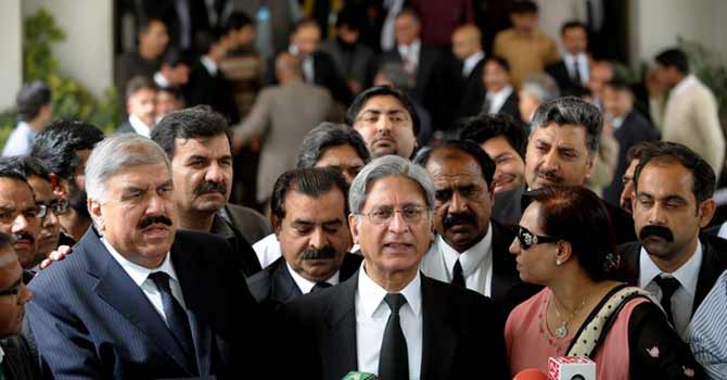 Senator Aitzaz Ahsan speaks to reporters outside the Supreme Court of Pakistan during the hearing of former prime minister Yousuf Raza Gilani's contempt of court case. – File photo by AFP