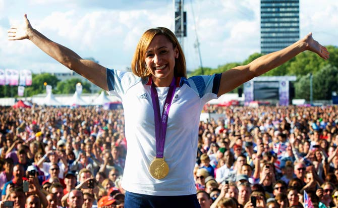 British track and field athlete Jessica Ennis wears her heptathlon gold medal while greeting fans at the BT London Live concert. - Photo by AP