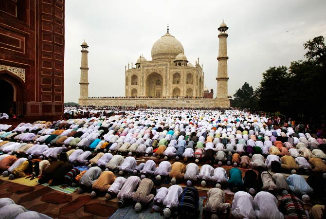 Indian Muslims offer Eid al-Fitr prayer at Shahi Masjid at the famous Taj Mahal in Agra. - Photo by AP