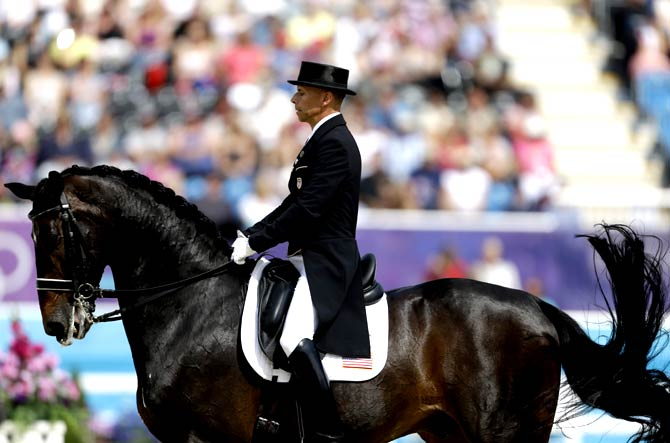 Steffen Peters, of the United States, rides his horse Ravel, in the equestrian dressage competition. - Photo by AP