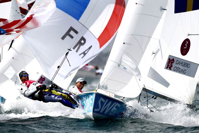 Anton Dahlberg and Sebastian Ostling of Sweeden sail during the 470 Men's dinghy race. - Photo by AP