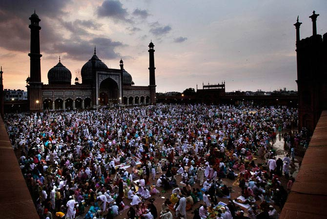 Indian Muslims break their Ramadan fast on the last Friday of the holy month of Ramadan, at the Jama Masjid, in New Delhi. - Photo by AP