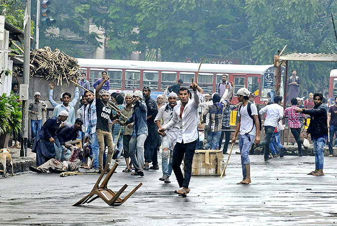 People react during a clash with police at a protest that turned violent in Mumbai. -Photo by Reuters