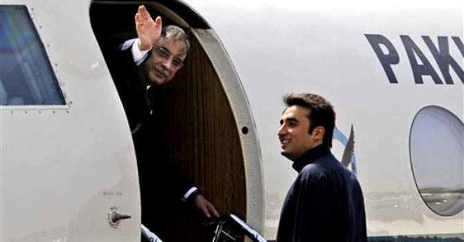 President Asif Ali Zardari, left, waves as his son Bilawal Bhutto Zardari looks on while departing for Jaipur at the Palam Airfield in New Delhi, India, Sunday, April 8, 2012. — File photo by AP