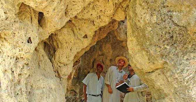 File photo shows members of the Capital Citizens Committee (CCC) and  Chairman Capital Development Authority (CDA) Imtyaz Inayat Elahi visit ancient Buddhist caves after they noticed suspicious activity during a recent visit to the sites in Shah Allah Ditta suburbs. - Dawn file photo