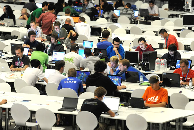 Young people work on their computers as they take part in the event.