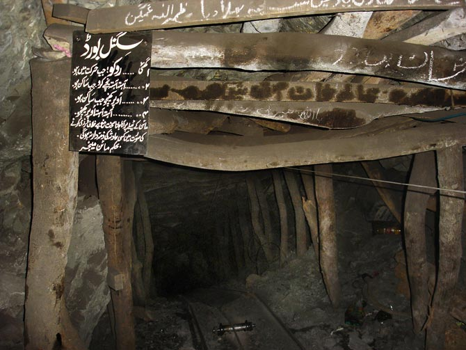 A tunnel of several hundred metres leading to the bottom of the mine. A board with guide-lines for the miners explains the code of bells that is used in the mine: Bells are supposed to be rung as signals while descending, ascending and exiting the mine.