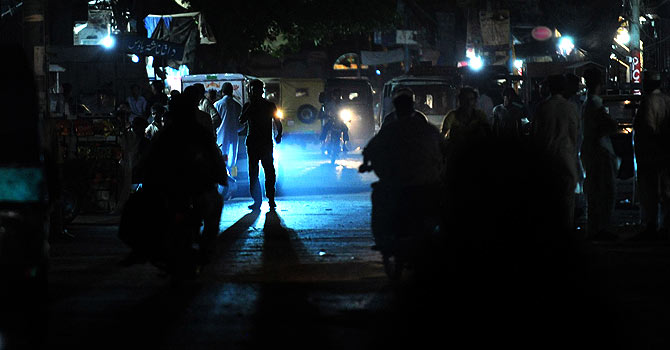 Commuters in Islamabad are pictured on a dark street during a power cut. – Photo by AFP