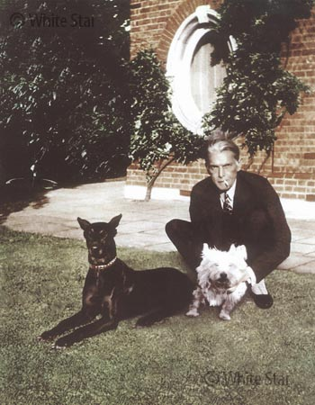 Quaid-e-Azam with his dogs.—Photo by White Star