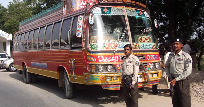 Police personnel guarding a bus at Ghazi Ghat Toll Plaza after killing of a terrorist, Abdul Ghafar Qaisarani, who was traveling in it and was shifting explosive. ONLINE PHOTO