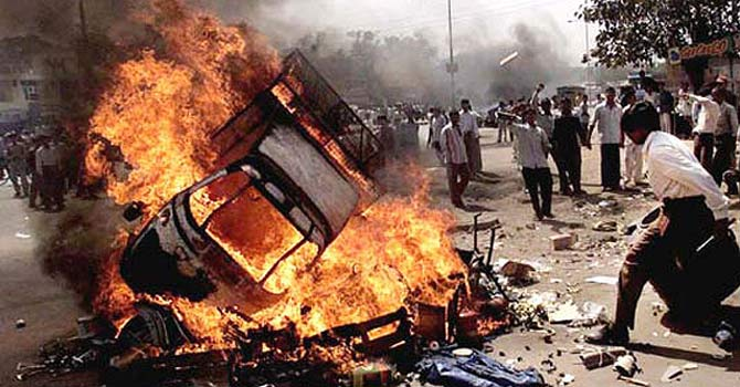 A file image shows burning and protests during the Gujarat riots of 2002. – Dawn file photo