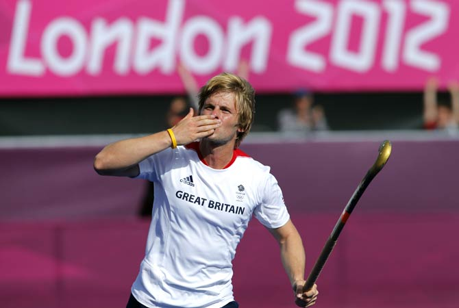 Britain's Ashley Jackson celebrates scoring a goal against Pakistan. - Photo by AP.