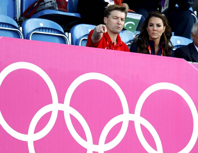 Catherine, Duchess of Cambridge sits with GB Hockey president Richard Leman (L) - Photo by Reuters.
