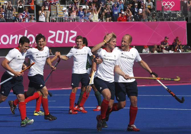 Britain's Ashley Jackson (2nd R) celebrates with his teammates after scroing a goal against Pakistan. - Photo by Reuters.