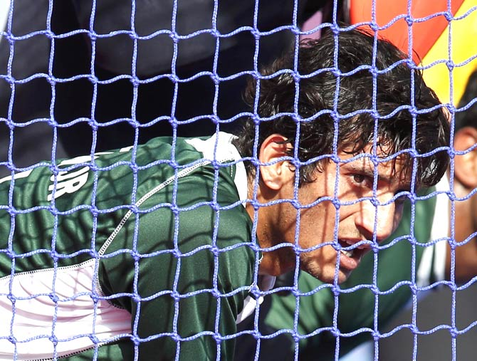 Pakistan's Muhammad Rizwan defends a penalty corner against Britain. - Photo by Reuters.