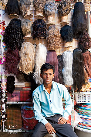 A man poses outside his shop at Bohri Bazaar. There was something slightly surreal, slightly beautiful and well, slightly creepy about this.
