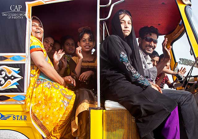 They told me ten of them, along with two water-coolers and a picnic basket in hand, came in a single rickshaw all the way from Karimabad. I challenged them to show me how and they agreed. Here they are – the family of ten in a rickshaw!