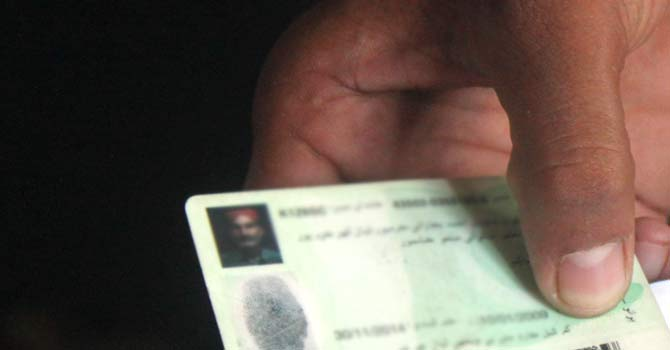 A Pakistani man shows his Computerized National Identity Card. – Photo courtesy Creative Commons