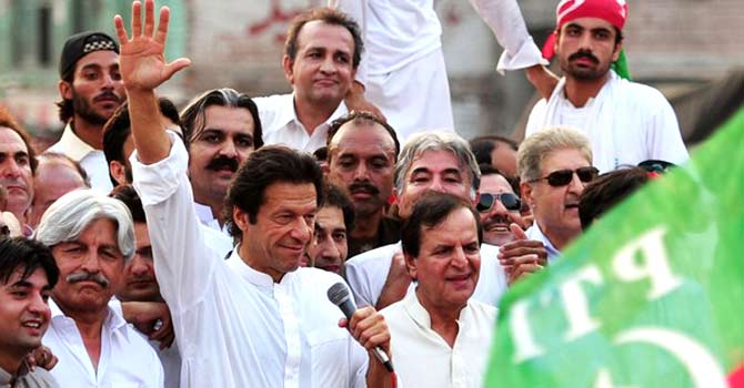 Chairman of Pakistan Tehreek-i-Insaf Imran Khan (C) waves during a protest rally against the reopening of the Nato supply route to Afghanistan, in Peshawar on July 14, 2012. — File photo by AFP