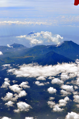 Majestic Bali's magic begins while you fly towards it and spot the many open-mouthed gaping volcanoes from the airplane window. Mount Agung and Mount Batur are the most well known.