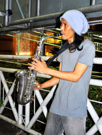 "Music, art and literature seem to thrive well in Indonesia. ""Low-Key"" was the name of this saxophone player, who played for my friends and I, enjoying his skill and it's effect on us."
