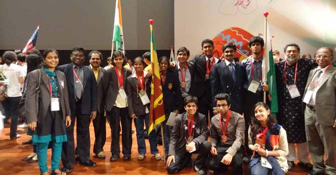 Students from Pakistan pose for photographs with students from India and Sri Lanka.