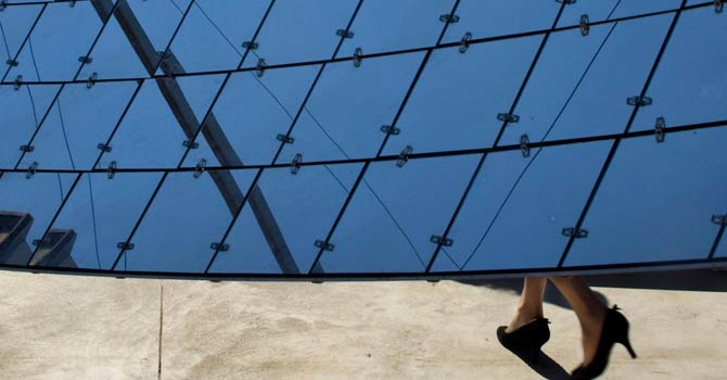 A visitor walks by a solar dish at a solar farm, which according to the manufacturer, are revolutionary in the way they efficiently produce maximum energy using a minimal area, in Kibbutz Kvutzat Yavne, Israel. Israel has a peak solar capacity of 212 megawatts, the vast majority of which comes from rooftop installations, that accounts for less than 2 per cent of the nationwide capacity according to the government-owned Israel Electric Corporation. – File photo by AP