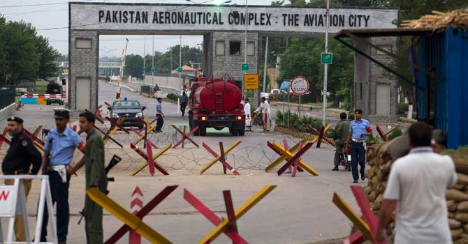 Security personnel guard the main entrance of Pakistan air force base in Kamra – Photo by AP