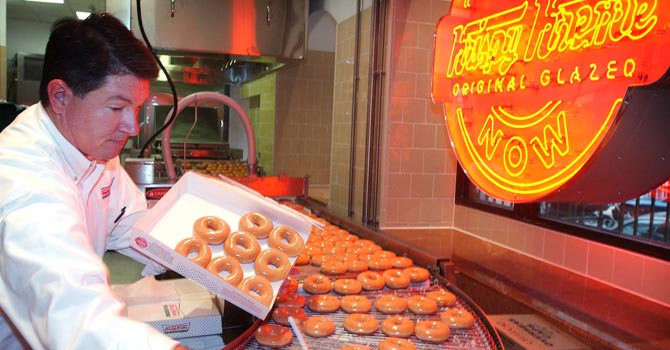 Krispy Kreme doughnuts go into production. — Reuters Photo