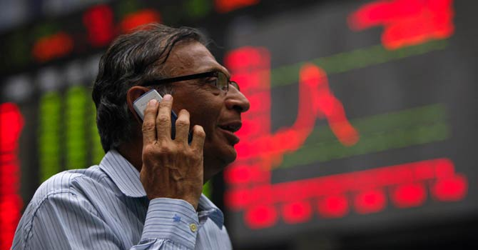 Trader at Karachi Stock Exchange — File Photo