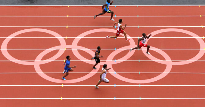 Liaqat Ali sprints (bottom end of the image) during his 100 metre preliminary heats. – Photo by Reuters