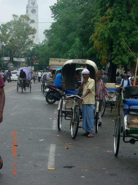 A cycle rickshaw driver relishes the beautiful weather.