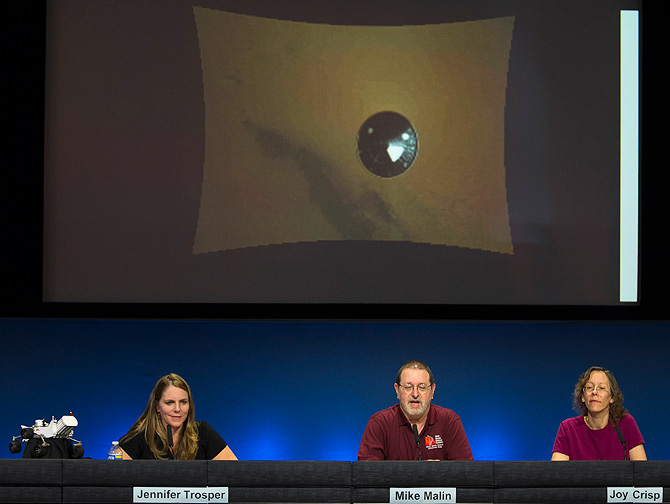 Jennifer Trosper, Mars Science Laboratory, MSL mission manager, JPL, left, Michael Malin, principal investigator, Mars Descent Imager, center, and Joy Crisp, MSL deputy project scientist, JPL take questions during a news briefing on the last data and imagery from Sol 1 at NASA's Jet Propulsion Laboratory in Pasadena, Calif., Monday, Aug. 6, 2012. NASA has released a low-resolution video of the Curiosity rover during the final few minutes of its descent to the Martian surface. An image shows the protective heat shie