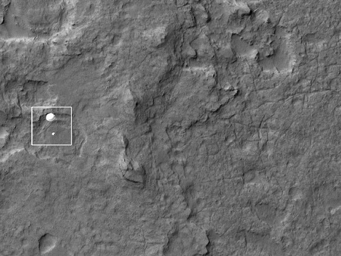 The High Resolution Imaging Science Experiment (HiRISE) camera aboard NASA's Mars Reconnaissance orbiter, captures the Curiosity rover still connected to its 51-foot-wide (almost 16 meter) parachute as it descends towards its landing site at Gale Crater on August 5, 2012, in this handout image courtesy of NASA. - Photo by Reuters