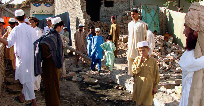 In this November, 2008 file photo, Pakistani tribesmen gather at a house destroyed by a suspected US missile in Mir Ali village near Miran Shah, the main town of Pakistan's North Waziristan tribal region. – File photo by AP