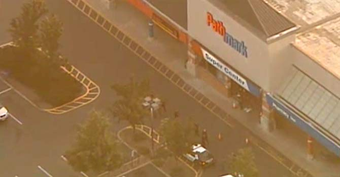A video grab from ABC News purportedly shows police officials outside the supermarket where the shooting occurred.