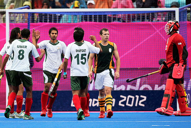 Pakistan's Abdul Haseem Khan (3rd L) celebrates scoring a goal against South Africa.