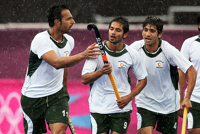 Abdul Haseem Khan (C) is congratulated by teammates after scoring a goal.
