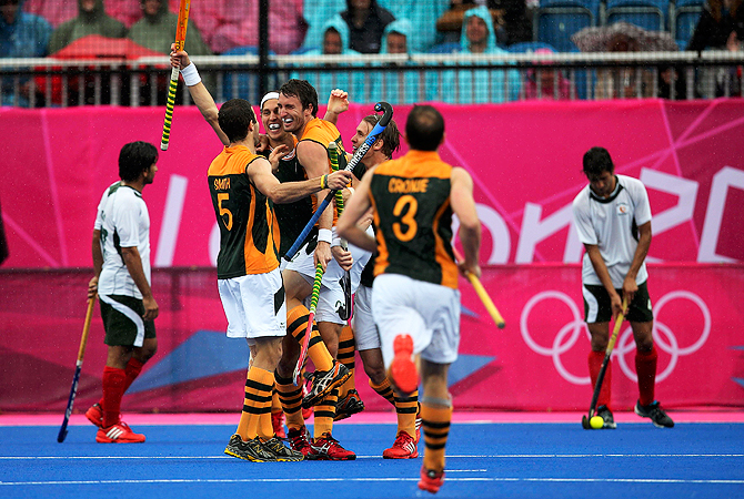 South Africa's Wade Paton (4th L) celebrates scoring a goal.