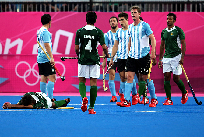 Pakistan's Muhammad Rizwan. senior, left, lies on the pitch after being hit by a ball as others look. -Photo by AP