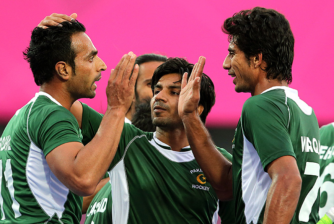Pakistan's Ahmed Waseem , center, and Muhammad Waqas, right, congratulate their captain Sohail Abbas for scoring a goal. -Photo by AP