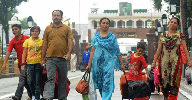Pakistani Hindu pilgrims arrive at the India-Pakistan border post in Wagah – Photo by AFP