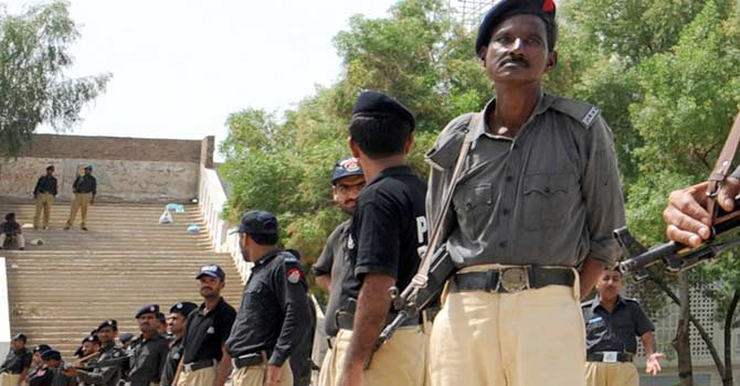 Police stand guard in interior Sindh. – File photo by AFP