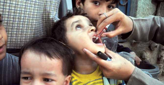 Polio drops being administered in Paksitan. – File photo by White Star