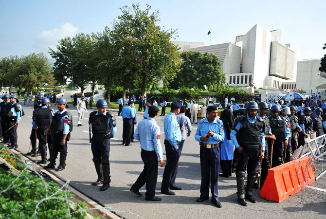 Policemen stand guard in front of the Supreme Court.