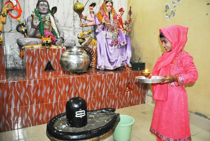 A girl makes an offering in her temple as part of the festivities. - File Photo