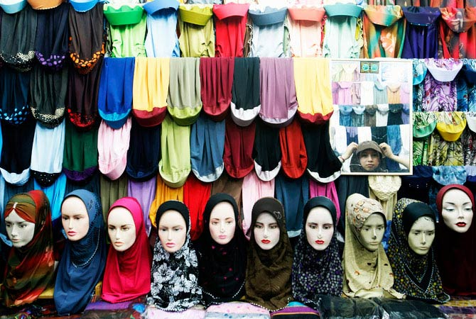 A Muslim woman shops for headscarves ahead of the Eid al-Fitr festival at a bazaar in Kuala Lumpur. - Photo by Reuters