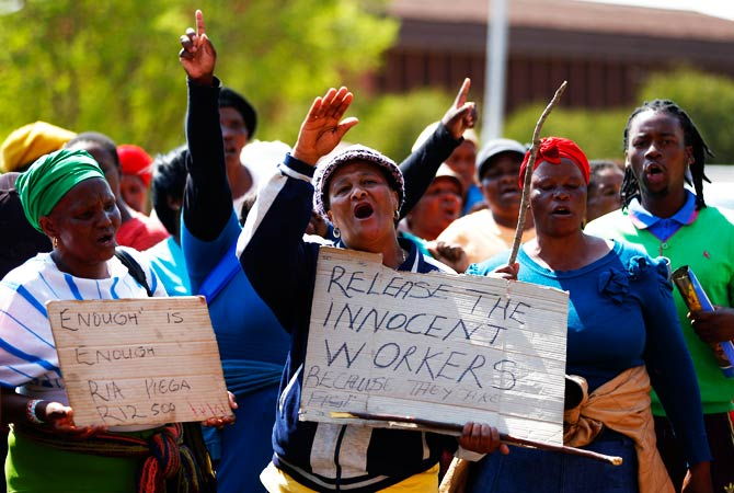 Supporters of arrested, striking platinum mine workers demonstrate outside the court in Ga Rankuwa. – Photo by Reuters