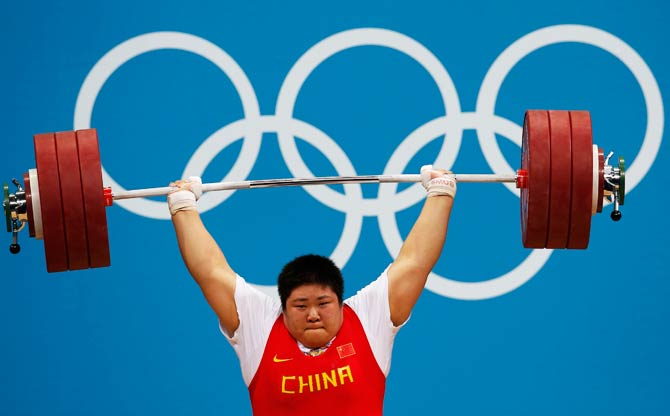 China's Zhou Lulu competes and wins the women's +75kg group A clean and jerk weightlifting competition. - Photo by Reuters